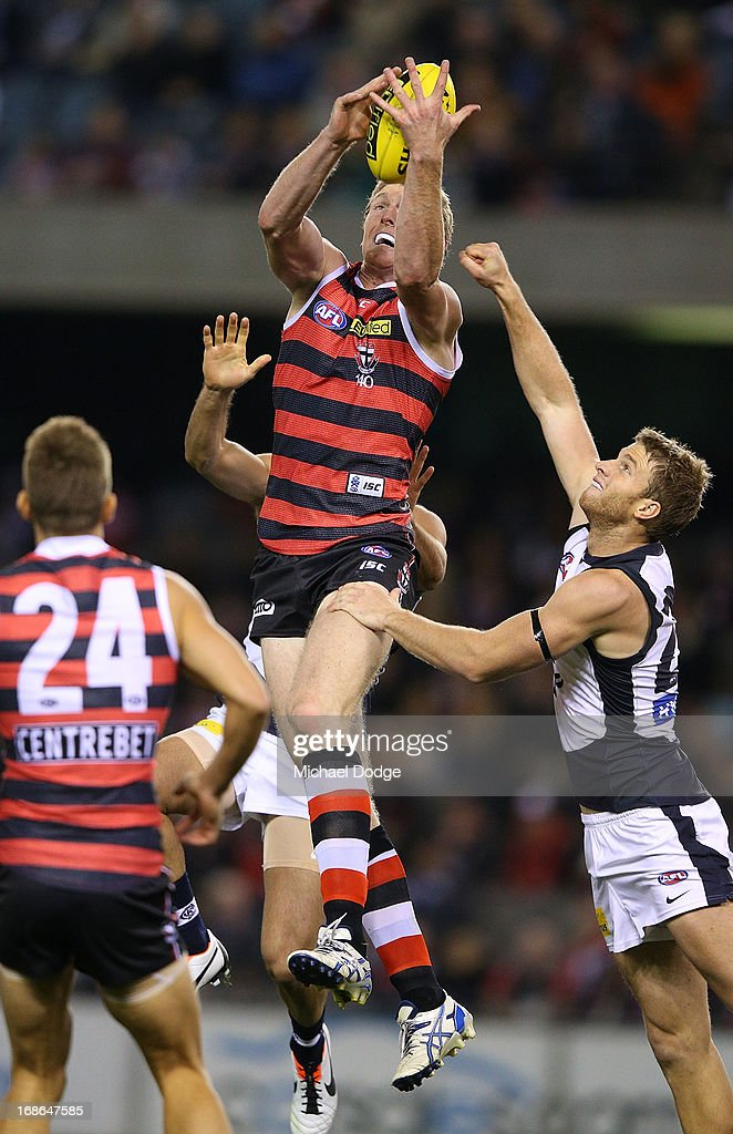 Ben McEvoy of the Saints marks the ball against Lachie Henderson of the Blues during the round seven AFL match between the St Kilda Saints and the Carlton Blues at Etihad Stadium on May 13, 2013 in Melbourne, Australia.