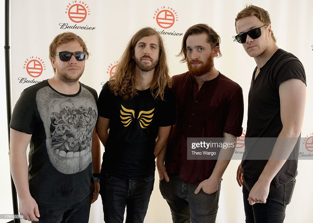 Ben McKee, Wayne Sermon, Daniel Platzman and <a gi-track='captionPersonalityLinkClicked' href=/galleries/search?phrase=Dan+Reynolds&family=editorial&specificpeople=8995077 ng-click='$event.stopPropagation()'>Dan Reynolds</a> of the band Imagine Dragons pose backstage during the 2013 Budweiser Made In America Festival at Benjamin Franklin Parkway on August 31, 2013 in Philadelphia, Pennsylvania.