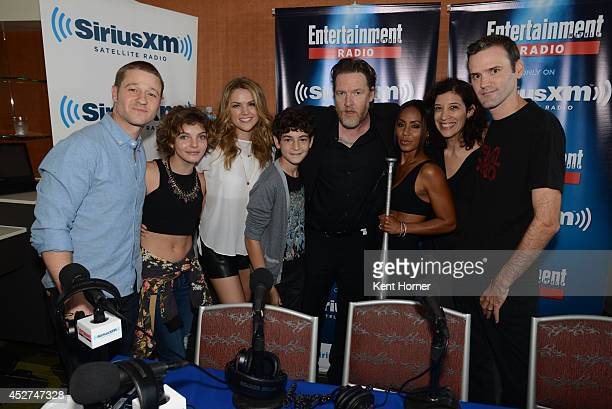 Ben McKenzie Camren Bicondova Erin Richards Donal Logue David Mazouz and Jada Pinkett Smith pose with radio hosts Jessica Shaw and Dalton Ross after...