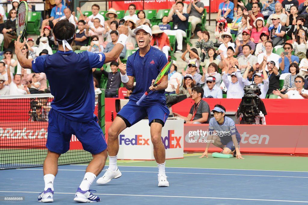 Ben McLachlan of Japan celebrates victory with doubles partner Yasutaka Uchiyama of Japan in their men's doubles final match against Jamie Murray of Great Britain and Bruno Soares of Brazil during day seven of the Rakuten Open at Ariake Coliseum on October 8, 2017 in Tokyo, Japan.
