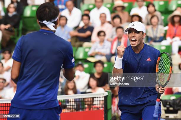 Ben McLachlan of Japan celebrates with doubles partner Yasutaka Uchiyama of Japan in their men's doubles final match against Jamie Murray of Great...
