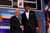 Ben McLemore of Kansas poses for a photo with NBA Commissioner David Stern after McLemore was drafted overall in the first round by the Sacramento...