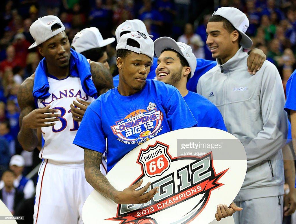Ben McLemore #23 (C) of the Kansas Jayhawks and team celebrate their 70-54 win over Kansas State Wildcats during the Final of the Big 12 basketball tournament at Sprint Center on March 16, 2013 in Kansas City, Missouri.