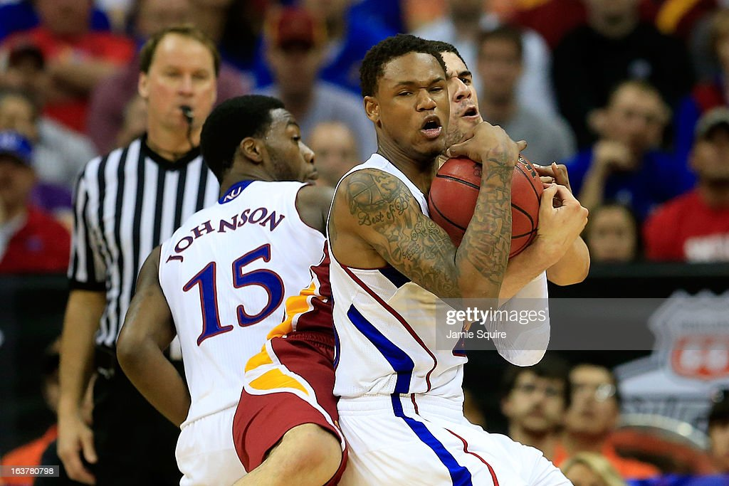 Ben McLemore #23 of the Kansas Jayhawks and teammate Elijah Johnson #15 battle for control of the ball against Georges Niang #31 of the Iowa State Cyclones in the second half during the Semifinals of the Big 12 basketball tournament at the Sprint Center on March 15, 2013 in Kansas City, Missouri.
