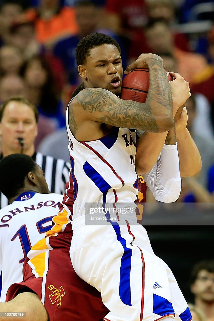 Ben McLemore #23 of the Kansas Jayhawks battles for control of the ball against Georges Niang #31 of the Iowa State Cyclones in the second half during the Semifinals of the Big 12 basketball tournament at the Sprint Center on March 15, 2013 in Kansas City, Missouri.