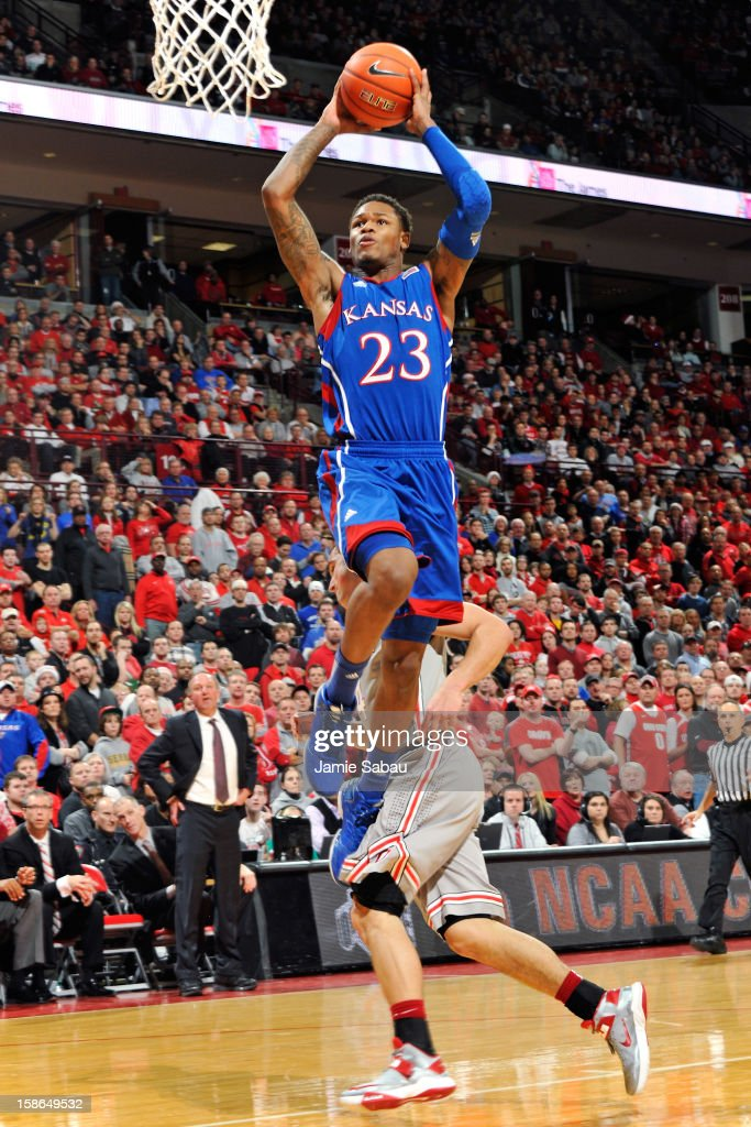 <a gi-track='captionPersonalityLinkClicked' href=/galleries/search?phrase=Ben+McLemore&family=editorial&specificpeople=9966388 ng-click='$event.stopPropagation()'>Ben McLemore</a> #23 of the Kansas Jayhawks completes a fast break with a dunk in the first half as <a gi-track='captionPersonalityLinkClicked' href=/galleries/search?phrase=Aaron+Craft&family=editorial&specificpeople=7348782 ng-click='$event.stopPropagation()'>Aaron Craft</a> #4 of the Ohio State Buckeyes trails on December 22, 2012 at Value City Arena in Columbus, Ohio.