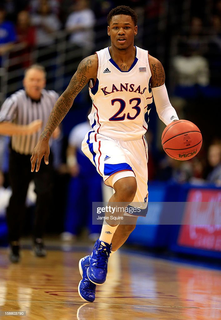 <a gi-track='captionPersonalityLinkClicked' href=/galleries/search?phrase=Ben+McLemore&family=editorial&specificpeople=9966388 ng-click='$event.stopPropagation()'>Ben McLemore</a> #23 of the Kansas Jayhawks controls the ball during the game against the American University Eagles at Allen Fieldhouse on December 29, 2012 in Lawrence, Kansas.