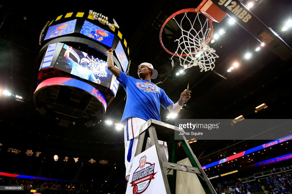 Ben McLemore #23 of the Kansas Jayhawks cuts the net in celebration of their 70-54 victory over the Kansas State Wildcats during the Final of the Big 12 basketball tournament at Sprint Center on March 16, 2013 in Kansas City, Missouri.