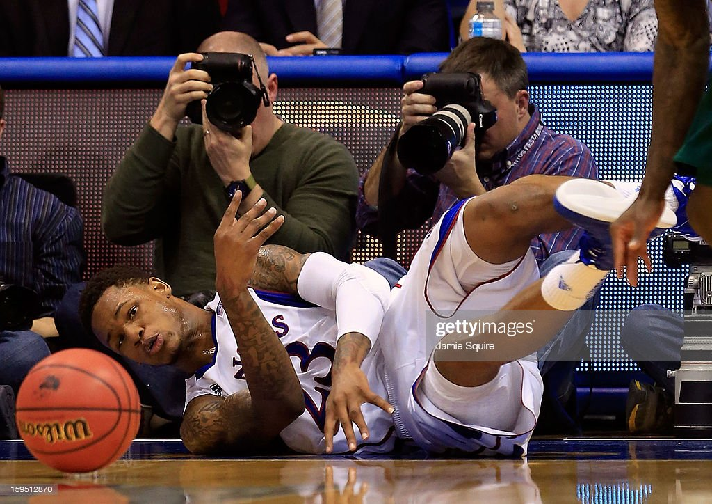 <a gi-track='captionPersonalityLinkClicked' href=/galleries/search?phrase=Ben+McLemore&family=editorial&specificpeople=9966388 ng-click='$event.stopPropagation()'>Ben McLemore</a> #23 of the Kansas Jayhawks dives for a loose ball during the game against the Baylor Bears at Allen Fieldhouse on January 14, 2013 in Lawrence, Kansas.