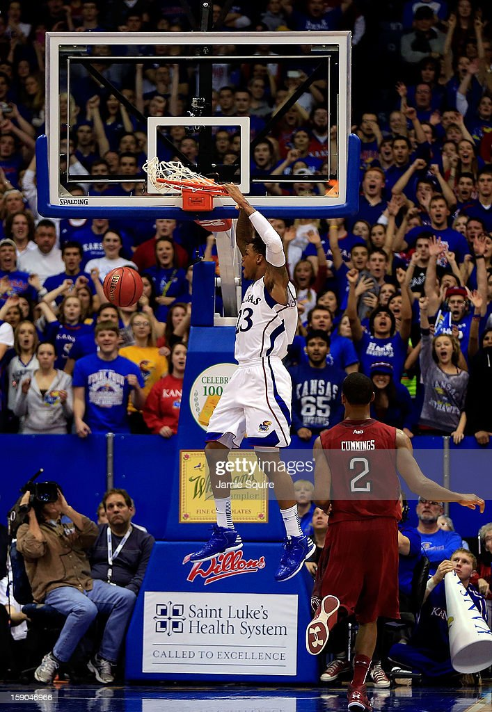 <a gi-track='captionPersonalityLinkClicked' href=/galleries/search?phrase=Ben+McLemore&family=editorial&specificpeople=9966388 ng-click='$event.stopPropagation()'>Ben McLemore</a> #23 of the Kansas Jayhawks dunks off a fast break during the last minute of the game against the Temple Owls at Allen Fieldhouse on January 6, 2013 in Lawrence, Kansas.