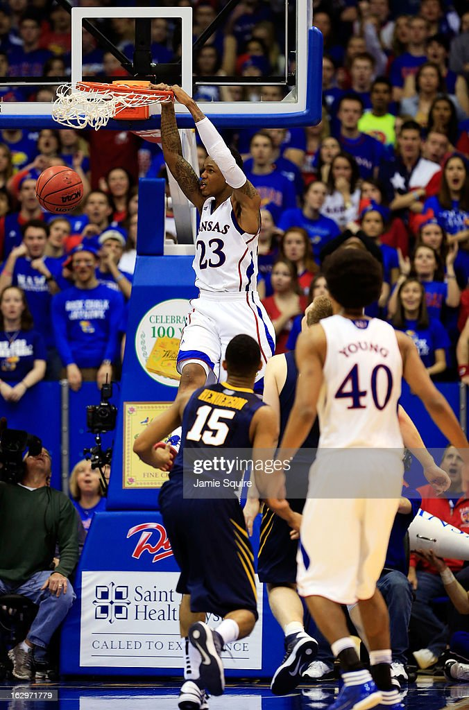 Ben McLemore #23 of the Kansas Jayhawks dunks off an alley-oop during the game against the West Virginia Mountaineers at Allen Fieldhouse on March 2, 2013 in Lawrence, Kansas.