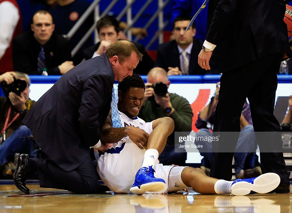 Ben McLemore #23 of the Kansas Jayhawks is attended to after getting hurt during the 2nd half of the game against the Baylor Bears at Allen Fieldhouse on January 14, 2013 in Lawrence, Kansas.