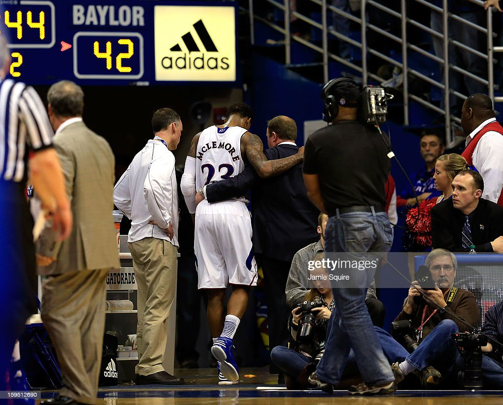 Ben McLemore #23 of the Kansas Jayhawks is helped back tot the locker room after getting hurt during the 2nd half of the game against the Baylor Bears at Allen Fieldhouse on January 14, 2013 in Lawrence, Kansas.