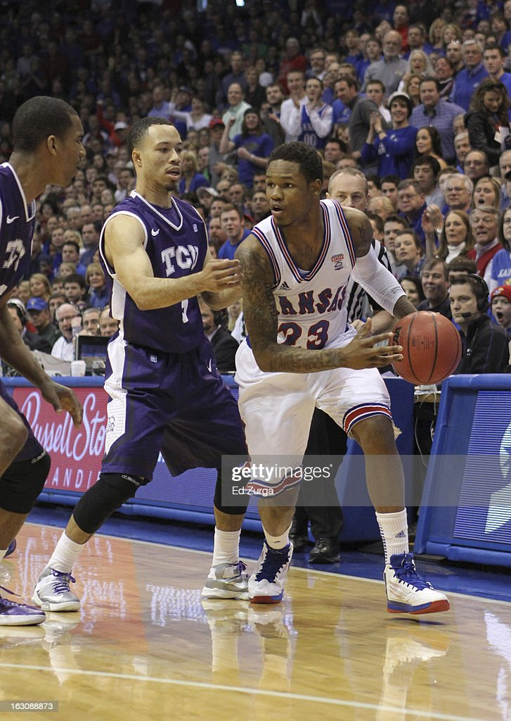 Ben McLemore #23 of the Kansas Jayhawks looks to pass around Kyan Anderson #5 of the TCU Horned Frogs at Allen Field House on February 23, 2013 in Lawrence, Kansas.