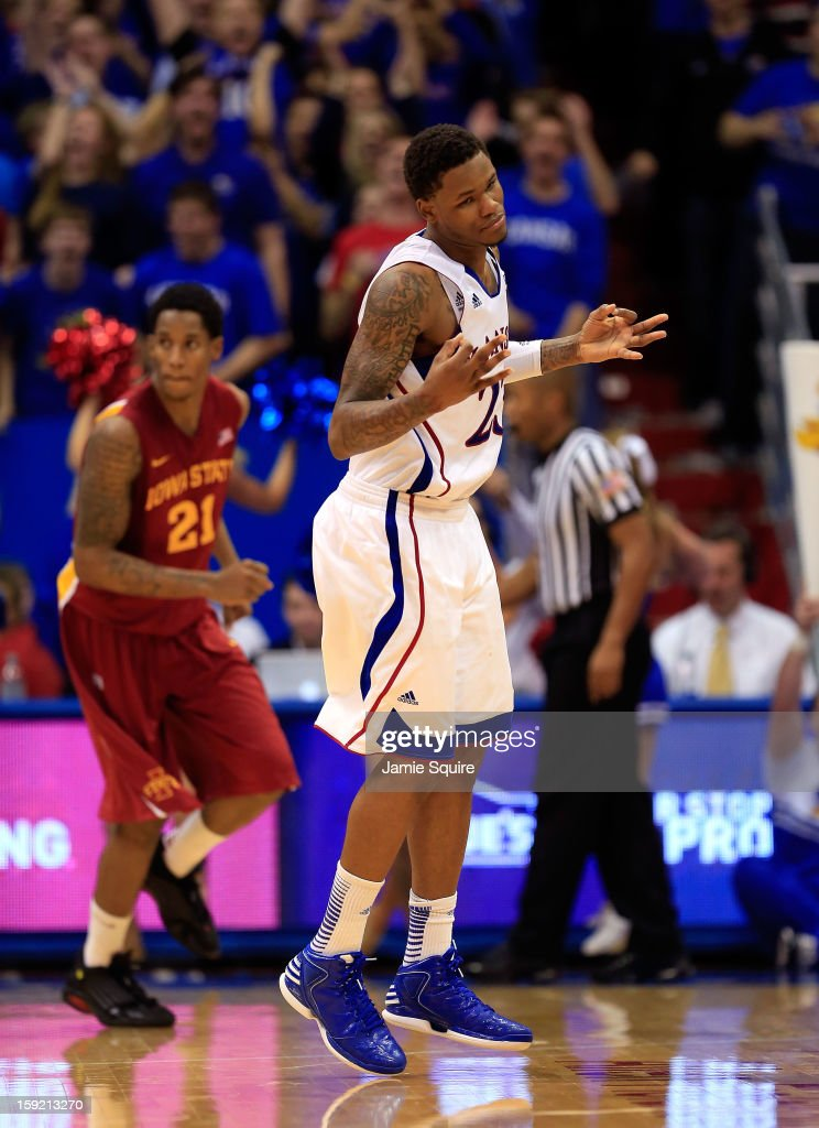 <a gi-track='captionPersonalityLinkClicked' href=/galleries/search?phrase=Ben+McLemore&family=editorial&specificpeople=9966388 ng-click='$event.stopPropagation()'>Ben McLemore</a> #23 of the Kansas Jayhawks reacts after sinking a three-pointer during the game against the Iowa State Cyclones at Allen Fieldhouse on January 9, 2013 in Lawrence, Kansas.