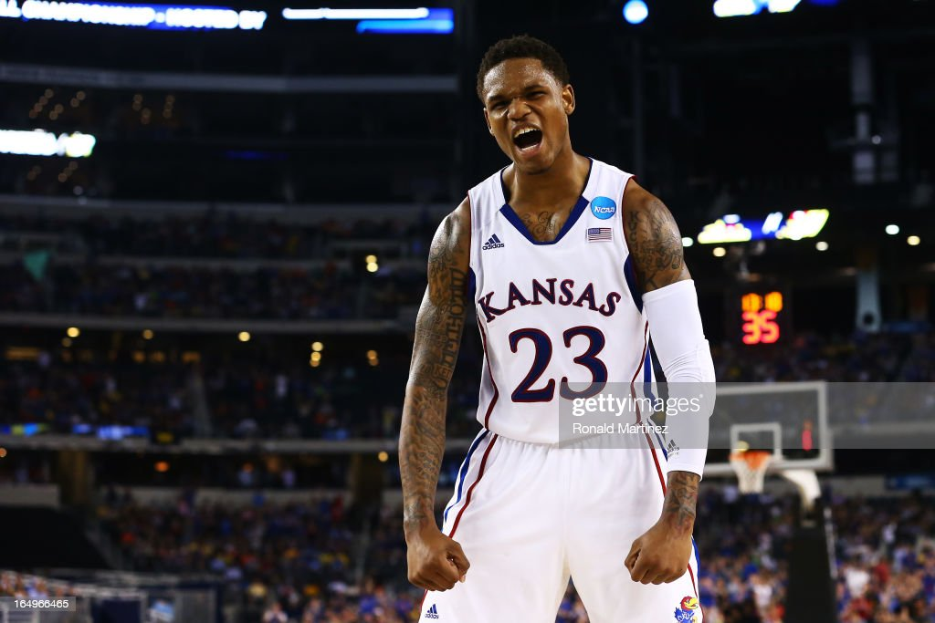 <a gi-track='captionPersonalityLinkClicked' href=/galleries/search?phrase=Ben+McLemore&family=editorial&specificpeople=9966388 ng-click='$event.stopPropagation()'>Ben McLemore</a> #23 of the Kansas Jayhawks reacts in the second half against the Kansas Jayhawks during the South Regional Semifinal round of the 2013 NCAA Men's Basketball Tournament at Dallas Cowboys Stadium on March 29, 2013 in Arlington, Texas.