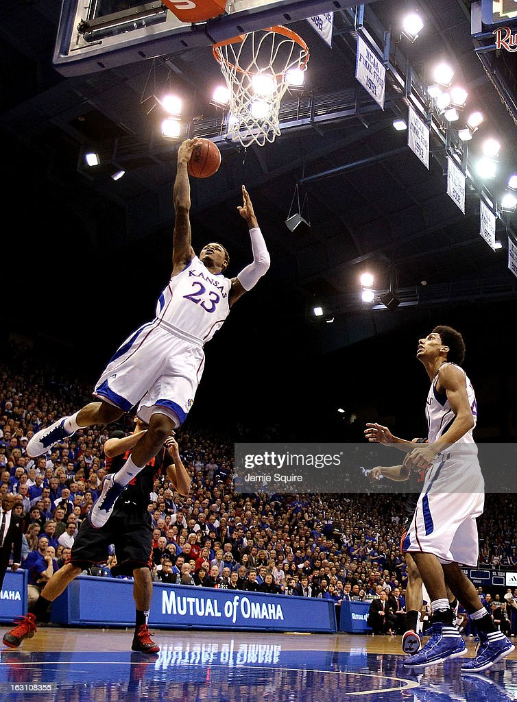 <a gi-track='captionPersonalityLinkClicked' href=/galleries/search?phrase=Ben+McLemore&family=editorial&specificpeople=9966388 ng-click='$event.stopPropagation()'>Ben McLemore</a> #23 of the Kansas Jayhawks scores on a fast break during the game against the Texas Tech Red Raiders at Allen Fieldhouse on March 4, 2013 in Lawrence, Kansas.