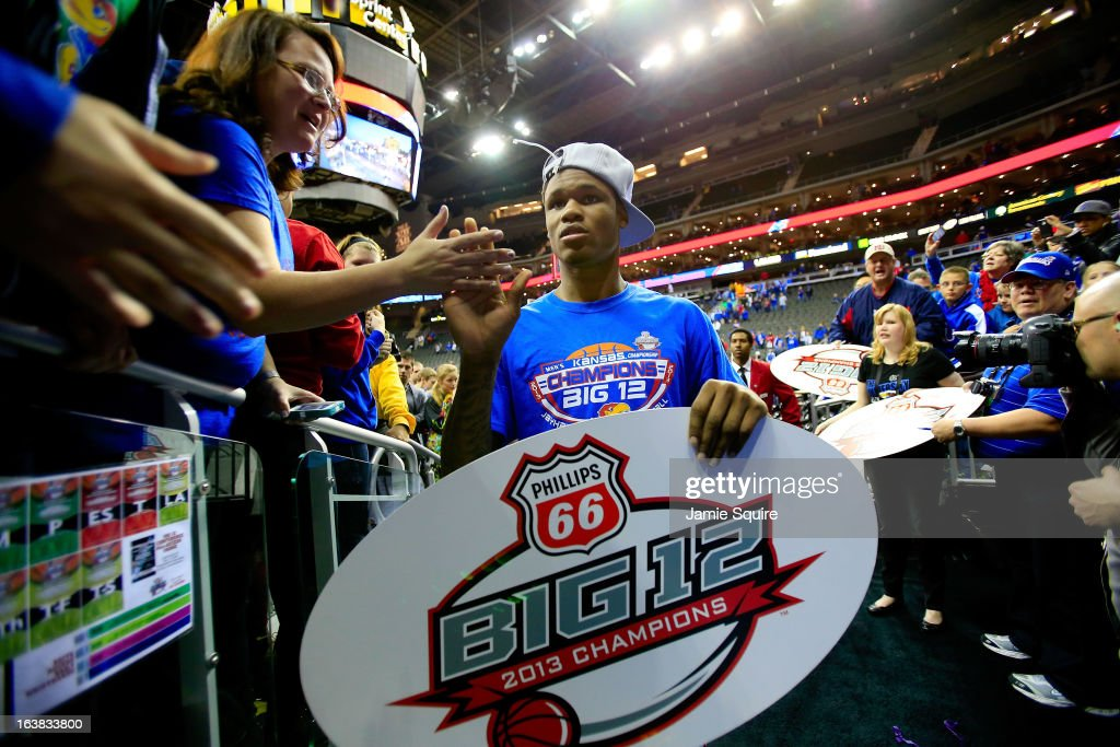 Ben McLemore of the Kansas Jayhawks shakes hands with fans while celebrating their 7054 win over Kansas State Wildcats during the Final of the Big 12...