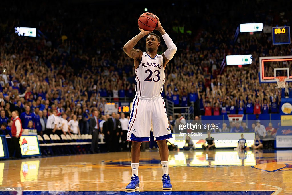 Ben McLemore #23 of the Kansas Jayhawks shoots a free throw after being fouled while scoring with an alley-oop dunk at the first half buzzer during the game against the Belmont Bruins at Allen Fieldhouse on December 15, 2012 in Lawrence, Kansas.