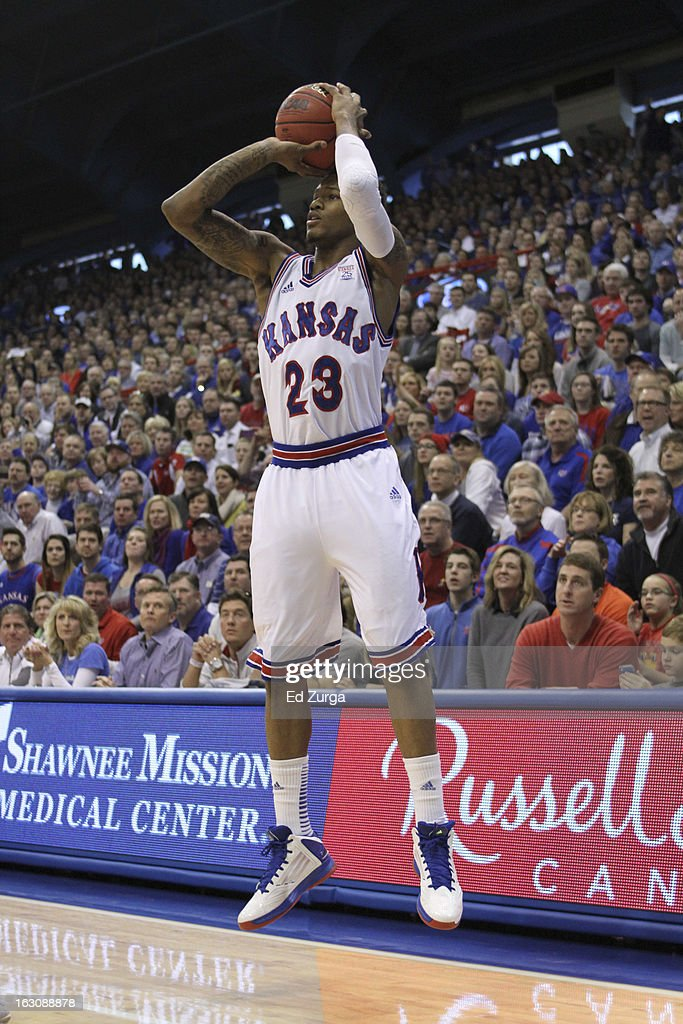 Ben McLemore #23 of the Kansas Jayhawks shoots against the TCU Horned Frogs at Allen Field House on February 23, 2013 in Lawrence, Kansas.