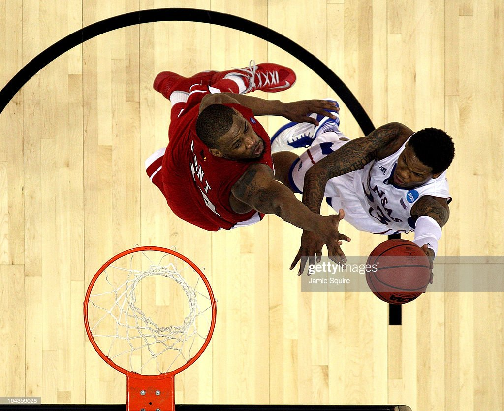 <a gi-track='captionPersonalityLinkClicked' href=/galleries/search?phrase=Ben+McLemore&family=editorial&specificpeople=9966388 ng-click='$event.stopPropagation()'>Ben McLemore</a> #23 of the Kansas Jayhawks shoots as George Fant #44 of the Western Kentucky Hilltoppers defends during the second round of the NCAA Basketball Tournament at the Sprint Center on March 22, 2013 in Kansas City, Missouri.