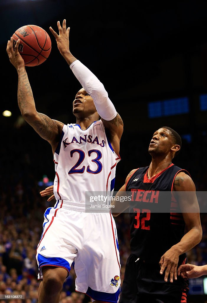 <a gi-track='captionPersonalityLinkClicked' href=/galleries/search?phrase=Ben+McLemore&family=editorial&specificpeople=9966388 ng-click='$event.stopPropagation()'>Ben McLemore</a> #23 of the Kansas Jayhawks shoots as Jordan Tolbert #32 of the Texas Tech Red Raiders defends during the game at Allen Fieldhouse on March 4, 2013 in Lawrence, Kansas.