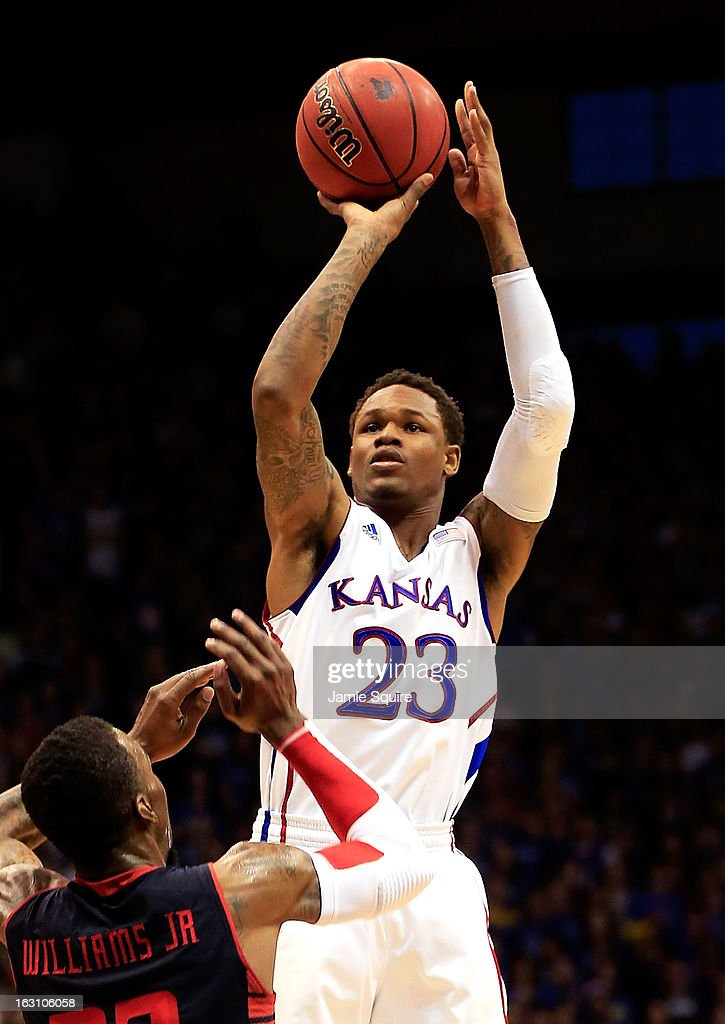 Ben McLemore #23 of the Kansas Jayhawks shoots over Jamal Williams, Jr. #23 of the Texas Tech Red Raiders during the game at Allen Fieldhouse on March 4, 2013 in Lawrence, Kansas.