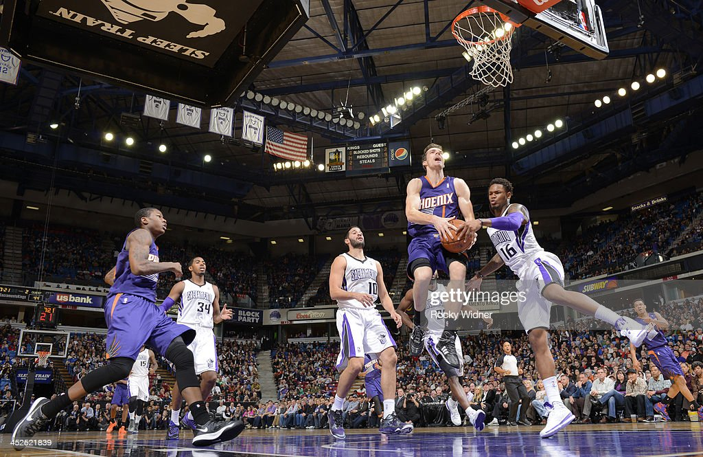 <a gi-track='captionPersonalityLinkClicked' href=/galleries/search?phrase=Ben+McLemore&family=editorial&specificpeople=9966388 ng-click='$event.stopPropagation()'>Ben McLemore</a> #16 of the Sacramento Kings attempts to strip the ball from <a gi-track='captionPersonalityLinkClicked' href=/galleries/search?phrase=Goran+Dragic&family=editorial&specificpeople=4452965 ng-click='$event.stopPropagation()'>Goran Dragic</a> #1 of the Phoenix Suns on November 19, 2013 at Sleep Train Arena in Sacramento, California.