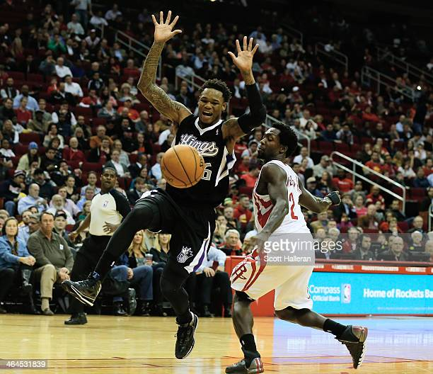 Ben McLemore of the Sacramento Kings battles for the ball with Patrick Beverley of the Houston Rockets during the game at the Toyota Center on...