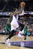 Ben McLemore of the Sacramento Kings drives towards the basket on Jeff Green of the Boston Celtics at Sleep Train Arena on February 22 2014 in...