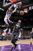 Ben McLemore of the Sacramento Kings dunks against Adreian Payne of the Minnesota Timberwolves on April 7 2015 at Sleep Train Arena in Sacramento...