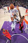 Ben McLemore of the Sacramento Kings dunks against Amir Johnson of the Toronto Raptors on December 2 2014 at Sleep Train Arena in Sacramento...