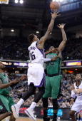 Ben McLemore of the Sacramento Kings goes up for a layup over Joel Anthony of the Boston Celtics at Sleep Train Arena on February 22 2014 in...