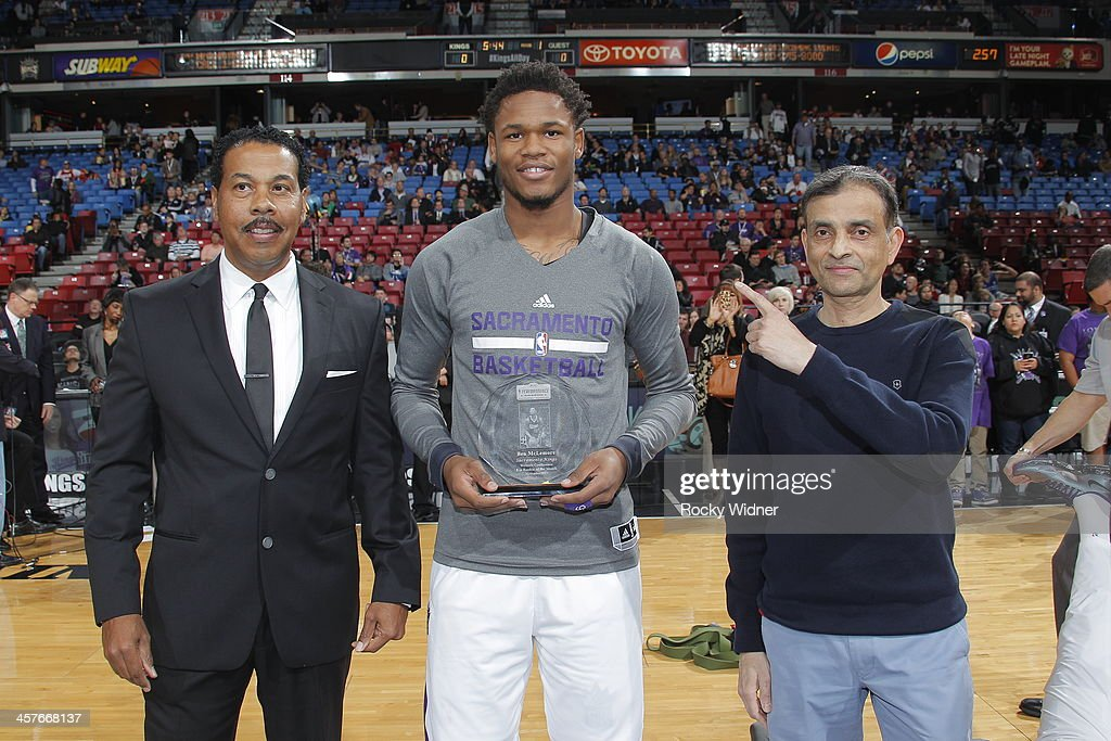 Ben McLemore #16 of the Sacramento Kings is honored as the Rookie of the Month alongside Owner Vivek Ranadivé of the Sacramento Kings prior to the game against the Houston Rockets on December 15, 2013 at Sleep Train Arena in Sacramento, California.
