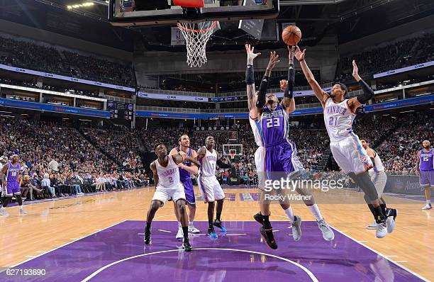 Ben McLemore of the Sacramento Kings puts up a shot against Steven Adams and Andre Roberson of the Oklahoma City Thunder on November 23 2016 at...