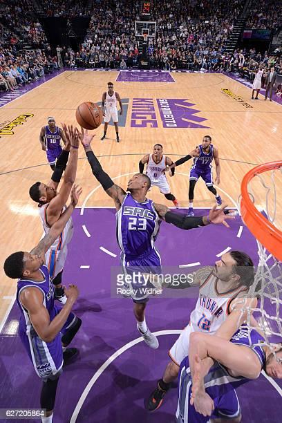 Ben McLemore of the Sacramento Kings rebounds against Andre Roberson of the Oklahoma City Thunder on November 23 2016 at Golden 1 Center in...