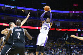 Ben McLemore of the Sacramento Kings shoots against the Brooklyn Nets during the 2014 NBA Global Games at the MercedesBenz Arena on October 12 2014...