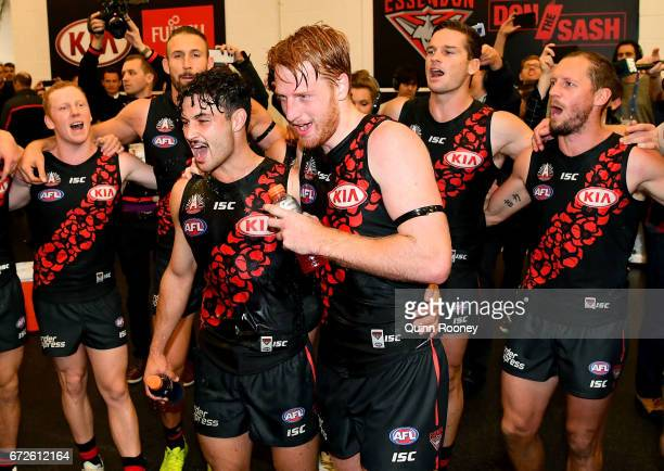 Ben McNiece and Aaron Francis of the Bombers sing the song in the rooms after winning the round five AFL match between the Essendon Bombers and the...