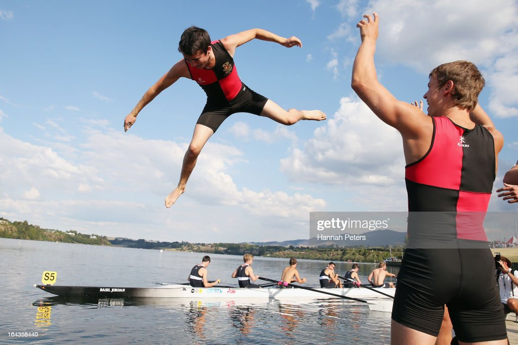 Ben McPherson of Hamilton Boys High School is thrown into the lake after winning the Maadi Cup during day six of the Maadi Cup at Lake Karapiro on March 23, 2013 in Cambridge, New Zealand.