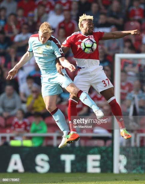 Ben Mee of Burnley and Adama Traore of Middlesbrough battle to win a header during the Premier League match between Middlesbrough and Burnley at...