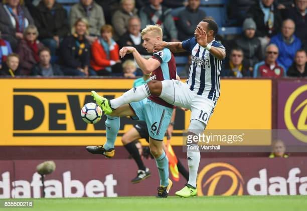 Ben Mee of Burnley and Matt Phillips of West Bromwich Albion battle for possession during the Premier League match between Burnley and West Bromwich...