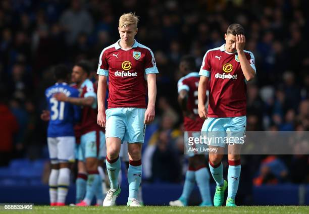 Ben Mee of Burnley and Robbie Brady of Burnley are dejected after the Premier League match between Everton and Burnley at Goodison Park on April 15...