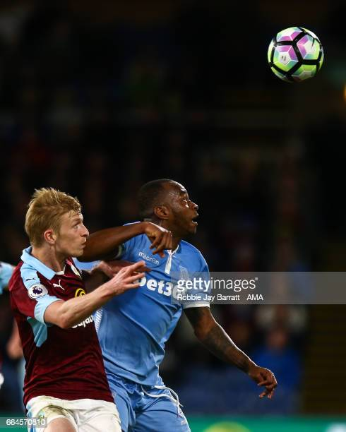 Ben Mee of Burnley and Saido Berahino of Stoke City during the Premier League match between Burnley and Stoke City at Turf Moor on April 4 2017 in...