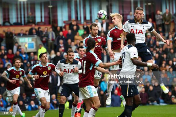 Ben Mee of Burnley and Toby Alderweireld of Tottenham Hotspur challenge for a header during the Premier League match between Burnley and Tottenham...