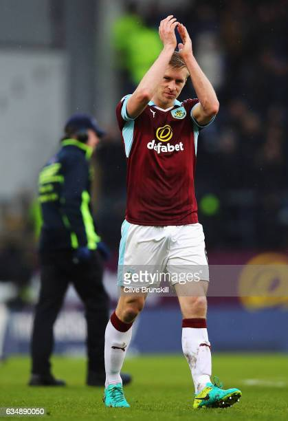 Ben Mee of Burnley applauds supporters during the Premier League match between Burnley and Chelsea at Turf Moor on February 12 2017 in Burnley England