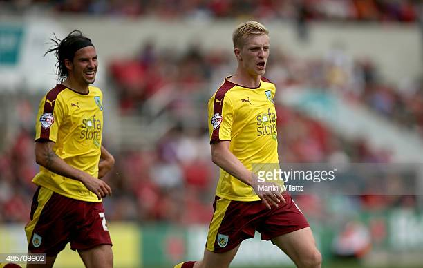 Ben Mee of Burnley celebrates scoring the opening goal with George Boyd during the Sky Bet Championship match between Bristol City and Burnley at...
