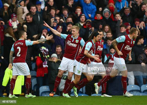 Ben Mee of Burnley celebrates scoring the opening goal with team mates during the Barclays Premier League match between Burnley and Crystal Palace at...