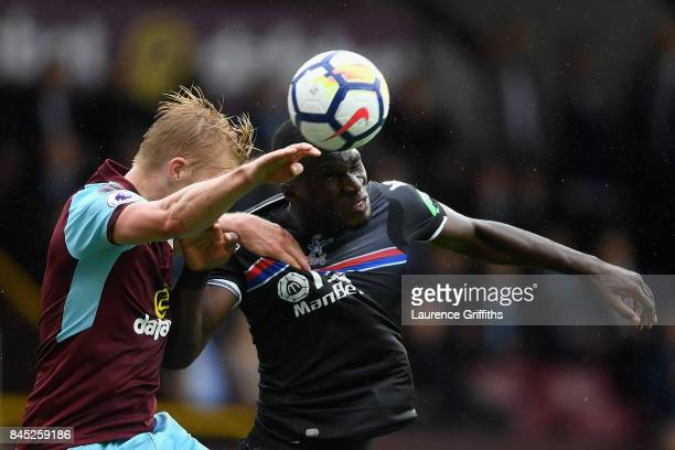 Ben Mee of Burnley Christian Benteke of Crystal Palace in action during the Premier League match between Burnley and Crystal Palace at Turf Moor on...