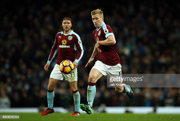 Ben Mee of Burnley controls the ball during the Premier League match between Manchester City and Burnley at Etihad Stadium on January 2 2017 in...