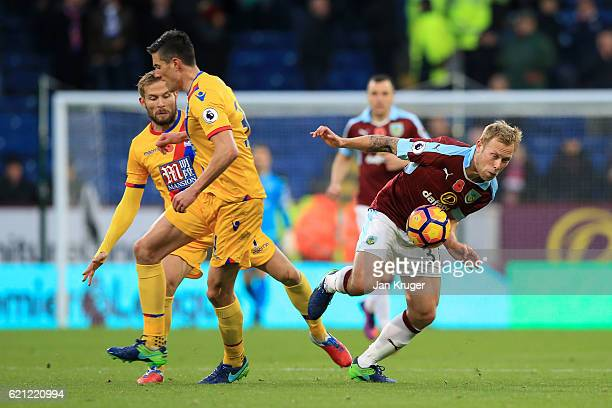 Ben Mee of Burnley evades Yohan Cabaye and Martin Kelly of Crystal Palace during the Premier League match between Burnley and Crystal Palace at Turf...
